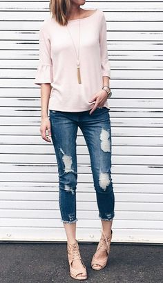 spring outfit idea: pink ruffle sleeve top with distressed cropped denim and wedges