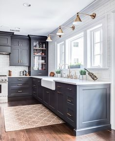 Black kitchen cabinets, brass light fixtures. Cabinet color is Benjamin Moore Wrought Iron.  Mad love kind of a navy black look #paintedcabinets
