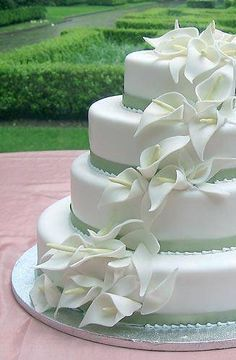 white lilies and green ribbon