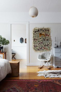 white walls and light wood floors