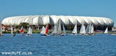 The Nelson Mandela Bay Stadium as you have NEVER seen it before - these dinghies make full use of the stadium as a backdrop during the Algoa Bay Yacht Club's World First dinghy regatta on the North End Lake. Port Elizabeth South Africa, Sailing Regatta, Dinghy, Nelson Mandela, Power Boats, Yacht Club, Fast Cars, First World, Marina Bay Sands