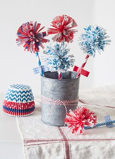 Use cupcake liners, paper straws, and washi tape (a craft trifecta!) to make these cute Fourth of July firework flower crafts. Happy July 4th! | Project Kid