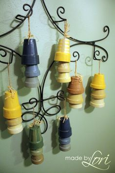 Wind Chimes: A few clay pots, some twine, some wooden beads inside, some paint, and glaze, and you get the cutest wind chimes!