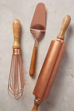 Copper & wood kitchen cooking utensils.