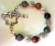 Beautiful handmade bracelet made with multicolored agate with antique silver finish spacer beads and butterfly toggle clasp. The bracelet is long, can re-size. Bracelet Making, Jewelry Making, Handmade Bracelets, Antique Silver, Agate, Tutorials, Butterfly, Beads, My Style