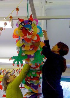 Collaborative Dragon! - great idea for a whole group of children to make a Chinese dragon for Chinese New Year celebrations