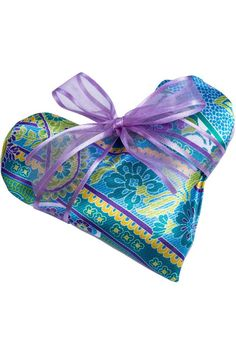 """This beautiful sachet is romantic and elegant. It is made with a lustrous paisley type of print in blue, purple, yellow, and green, and is filled with delightful lavender buds. You can put it in a drawer with your intimates to infuse with clean and fresh fragrance, but you might want to keep this sachet out, just because it is so pretty!    Measures: 6"""" x 5.5"""" x 1.25""""   Lavender Heart Sachet by Sonoma Lavender. Home & Gifts - Gifts - Scents & Bath Boulder, Colorado"""