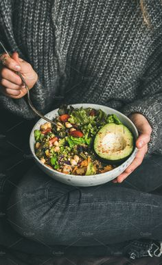 Woman sitting and eating healthy vegetarian dinner from Buddha bowl by sonyakamoz. Woman in jeans and warm woolen sweater holding bowl with fresh salad, avocado, grains, bea. Healthy Food Blogs, Healthy Foods To Eat, Healthy Drinks, Eating Healthy, Clean Eating, Eating Vegetables, Roasted Vegetables, Diet Recipes, Healthy Recipes