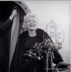 Marilyn Monroe. Roses sitting. Photo by Milton Greene, 1956.