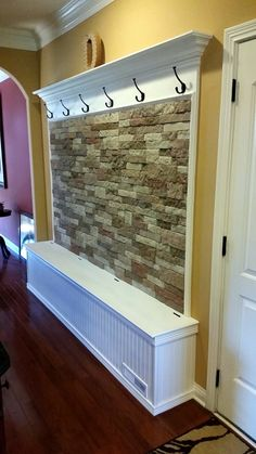 My husband built this for a narrow hallway (or could be used in small mudroom) to keep coats and backpacks. The bottom is storage for shoes, hats, gloves, umbrellas, etc. All wood construction and Air Stone available at Lowe's. The Airstone is a mix of Vineyard Blend and Autumn Mountain.