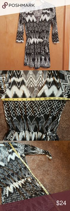 Tribal print romper Polyester spandex blend, 3/4 length sleeves, wrap style front, elastic waist and tie in front, direct from distributor without store tags boutique Pants Jumpsuits & Rompers