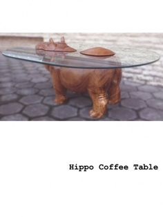 Hippo Coffee Table hippo table emerging out of glass surfaces design - the spirit of