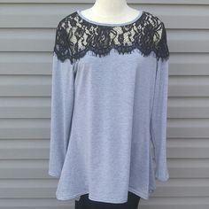 Gray long sleeve top with black lace Gray long sleeve flowing top with black lace.   I have 3. Please don't buy this listing. When you are ready to purchase ask me to set you up a listing.   These are NWOT Retail. Price Firm Unless Bundled. Measurements available upon request. Tops