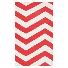 Add a pop of pattern to your living room or den with this artfully crafted rug, showcasing a classic chevron motif in poppy.  Produc...