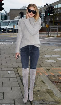 Fashionable flyer: The 20-year-old was photographed in suede boots at Heathrow Airport on Monday