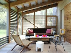 deep porch, screens, horizontal shade strips, sliding door.  so many things i love in one place.