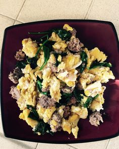 #Meal #2 of the day!! 3 scrambled #eggs 1/2 of a #leftover homemade #burger about a cup of #spinach - all cooked in #bacon #fat!! Gonna slap some #salsa on top and call it #YUMMY!  @coachkimmie