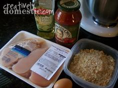 Crockpot Chicken Parmesan 2-4 boneless, skinless chicken breast halves 1/2 cup bread crumbs 1/4 cup Parmesan cheese 1/2 teaspoon Italian Seasoning 1/4 teaspoon black pepper 1/4 teaspoon kosher salt 1 tablespoon olive oil 1 egg, beaten sliced mozzarella cheese Jar of marinara sauce