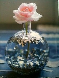 Such a cute idea. Add glitter or sequins to water to glam up any vase