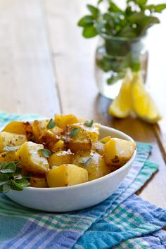 Lemon and Oregano Potatoes by A Communal Table (different cooking method - I must try this!)