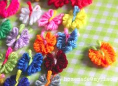 Tiny Yarn Butterflies- use up your yarn scraps in the cutest way possible! I think I could make 100 of these with all my scrap yarn...