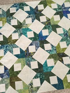 Have to look closely, but it is an easy jelly roll block with snowballed corners. Would be a great scrap buster!
