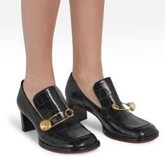 Shop the Regent Safety Pin Loafer  Shoe in Black Croc Print Leather at Mulberry.com. A feminine take on the iconic loafer, the Regent Safety Pin style features a gold pin embellished with mother-of-pearl and a rabbit head button.The wide straight heel is complemented by a square toe shape and a classic loafer tongue covering the instep.