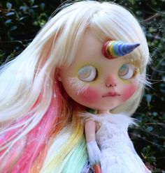 Iris is a one of a kind Custom Blythe doll. She is my 115th custom Blythe doll. -A lot of time, thought,effort, and love went into making Iris. -Iriss theme is half unicorn and half goddess...she is both things at once. Iris is the Greek goddess of the rainbow. -Iris is originally a TBL Blythe Doll. -Iris will be packaged securely with care.  WORK DONE: -Face,nose, and philatrum carving. -Face Up done with high quality Schminke & Pan pastels, water color pencils,water color paints, and ac...