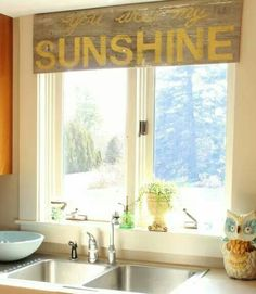 Kitchen/MY SUN MOON AND STARS sign!