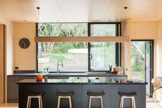 Kitchen | Plywood and black stone bench #kitchens #archiblox