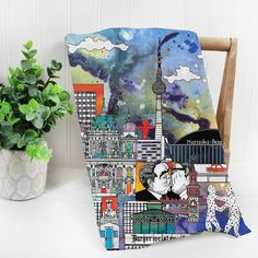 church items Mehas lively Berlin drawing decorates this abstract cotton tea towel featuring a rich background of blue, red, green and yellow. For international customers, please order thi Travel Gifts, Tea Towels, House Warming, Berlin, Skyline, Watercolor, Abstract, Drawings, Panama