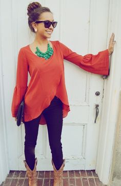love the combination of 2 bold colors.  tight pants, a looser shirt, casual boots but a fancier clutch and necklace.  Sweet!