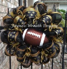 Saints Football Wreaths with Fleur de lis ribbon def not a fan, but a pats wreath would do the trick!