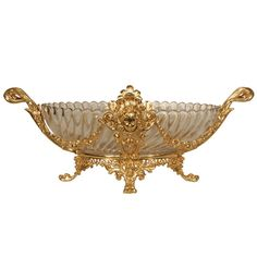 View this item and discover similar for sale at - A stunning French century Louis XVI st. Baccarat crystal and ormolu centerpiece. The centerpiece is raised on four ormolu paw feet below a scrolled Crystal Centerpieces, Vintage Centerpieces, Centrepieces, Antique Furniture Stores, Ancient Greek City, Feet Gallery, Female Mask, Baccarat Crystal, Design Movements
