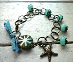 Items similar to Starfish. Beach Bracelet. Tiffany blue Lampwork Spacer Beads. Dark brass chain. Czech picasso glass. Vintaj starfish charm. silk ribbon. on Etsy