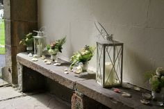 Beautiful Posies of fresh flowers, lanterns and a sprinkling of delicate rose petals greeted the guests in the porch area
