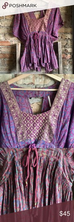 Free People Boho Purple Top Free People Bobo top in excellent condition absolutely no signs of wear or damage. Beautiful embroidered detail, open back and bold purple color. Size XS, fit is loose so in can also be worn up to a Small Free People Tops Tunics