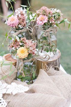 burlap / wood logs / blooms / flower arrangements / glass jars                                                                                                                                                     More