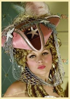The Rianna - Seafaring Pirate Hat - Tricorn - As Seen in Gothic Beauty Magazine.  Etsy has it for $289.  Not sure I want to go Antoinettish - but, wowser!  It's like the siren grabbed the hat from a pirate and made it her own, right?