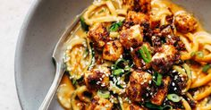 Spicy Sesame Zoodles with Crispy Tofu! SUPER easy recipe using sesame oil, peanut butter, soy sauce, garlic, ginger, zucchini, and tofu. Vegan.