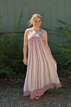 Bohemian style maxi dress with adjustable spaghetti straps.  Perfect for beach vacations or just as a swim suit cover up.