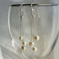 Look easy enough to make! Pearl earrings freshwater coin pearls sterling by KGarnerDesigns