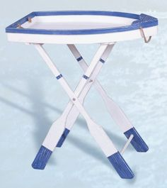 """Wood Nautical Boat Table by HS. $94.95. It will add a definite nautical touch to wherever it is placed and is a must have for those who appreciate high quality nautical decor.. It features a distressed white & blue boat sitting atop a stand made to look like oars.. It makes a great gift, impressive decoration and will be admired by all those who love the sea.. The wood boat table measures 25"""" x 14"""" x 27"""".. The wood boat table measures 25"""" x 14"""" x 27"""". It features a d..."""