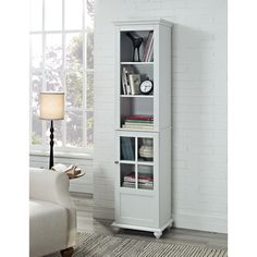 Add extra storage space to any room with this attractive storage cabinet from Altra. The Reese Park storage cabinet is offered in three sizes in a clean white finish with a classic silhouette and solid wood bun feet.