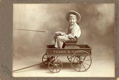 Boy in wagon by Mirror Image Gallery, via Flickr