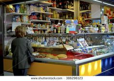 MALAGA, SPAIN - March Mercado Central De Atarazanas Woman buying food on famous spanish indoor market, architectural building from century, located in the center of Malaga Malaga Spain, Places In Europe, March 4, Spain Travel, 19th Century, Spanish, Photo Editing, Indoor, Stock Photos