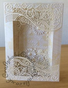 3D Frame Wedding Card made using a variety of dies including; Tattered Lace large Panorama dies and nesting rectangles, Tattered Lace double delight adore, Sparkle corner die, Spellbinders Blooms 1, and Flourish from Spellbinder flower bundle set. Britannia Sentiment dies.