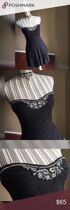 """Free People Dress Black Lace Strapless Dress w/Beaded Embellishment by Free People. Size M. Layer of tulle peeks out below the lace hem. Loops to add straps if you want, straps not included with the dress. No slip strip in bust. Bust 30"""" lying flat, stretches to 36"""". Bust to hem length 27"""". Free People Dresses Strapless"""