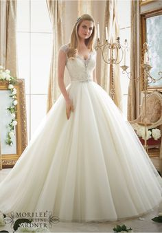 Wedding Dresses and Wedding Gowns by Morilee featuring Intricately Beaded Embroidery on Circular Tulle Ball Gown Removable Beaded Satin Belt included. Colors Available: White/Silver, Ivory/Silver, Light Gold/Silver