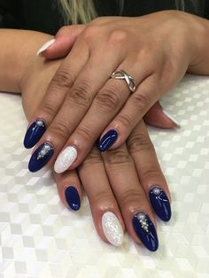 Marine blue with sparkly white accented gel nails. Pearl decorations as well